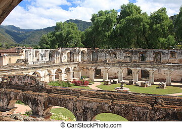 Santa Clara Convent ruins, Antigua - Gardens and arched...