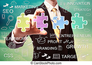 Businessman with puzzle and ideas - Businessman pinching a...