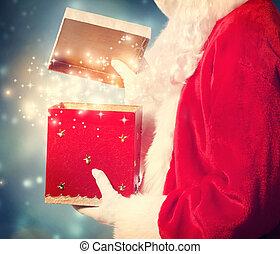 Santa Claus Opening a big Christmas Gift - Santa Claus...