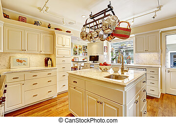 Kitchen room with island and hanging pot rack - White...