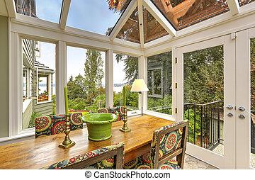 Sunroom patio area with dining table set - Sunroom patio...