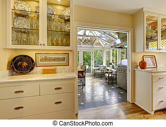 Kitchen room with exit to patio area in sunroom Kitchen...