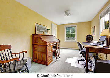 Yellow office room interior with antique furniture