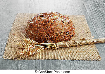 rye bread - loaf of sour cherry and walnut rye bread on...