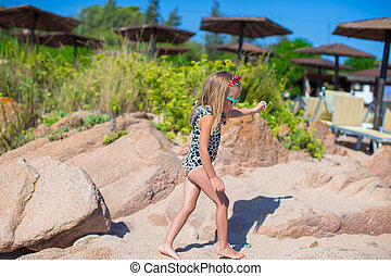 Adorable cute girl have fun on white beach during vacation -...