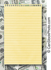 blank yellow paper over money background for writing