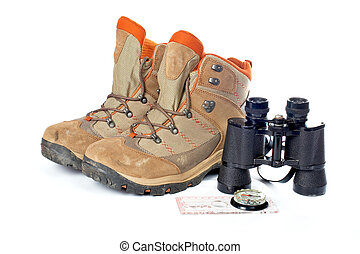 Adventure kit - Hiking boots, compass and binoculars on a...