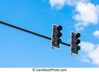 image of traffic light, the green light is lit. symbolic for...