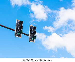 image of traffic light, the green light is lit. symbolic  for go