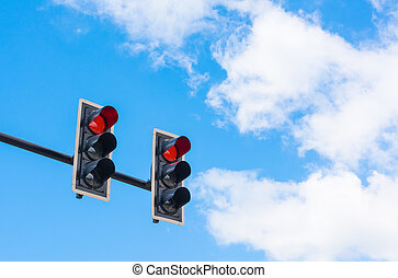 image of traffic light, the red light is lit symbolic for...