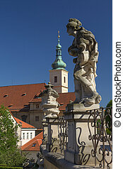 Baroque staues and famous Church in Prague