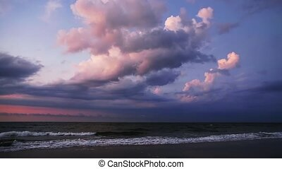 Atlantic Dawn Loop - Ocean surf with billowing clouds above...