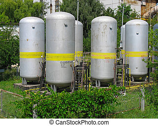 Industrial chemical tanks at power plant