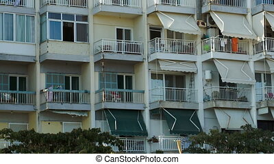 Hotel on summer resort - Panning shot of hotel facade with...