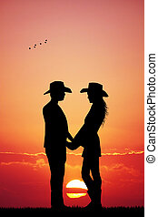 cowboy and cowgirl at sunset - illustration of cowboy and...