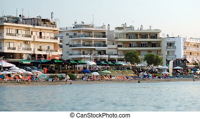 Crowded resort at seaside - Resort at seaside with many...