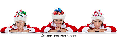 Christmas banner with kids wearing santa hats full of...