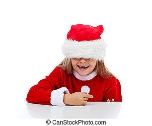 Happy little girl in Santa costume