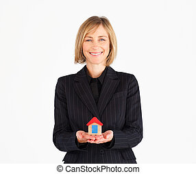 Business manager holding house - Female business manager...