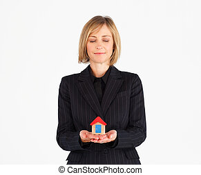 House in humans hand - Mature businessmanager holding house...