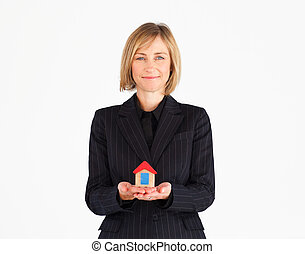 Female mature business manager presenting house solution -...