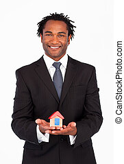 Friendly businessman showing constructions of house
