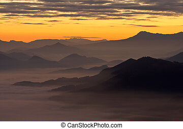 Mountains over the fog in the winter sunrise