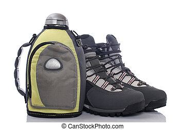 Hiking boots and canteen - A pair of hiking boots and...