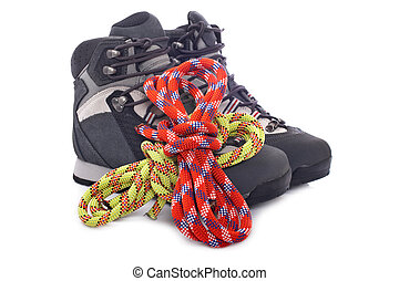 Climbing gear - Hiking boots and two rope reflected on white...