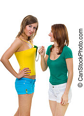 two women quarrel - two young women have a conflict standing...
