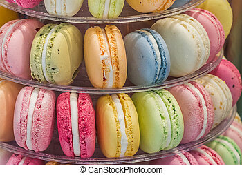 Macarons in different colors and flavors, displayed on an...