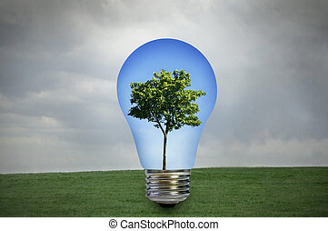 Environmentally friendly energy - Green tree with blue sky...