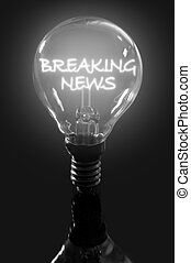 Breaking news - Lit bulb with breaking news illuminated text...