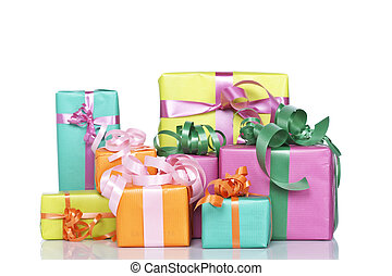 Assortment of gift boxes, reflected on white background....