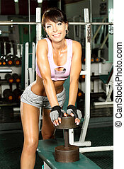 pretty sophisticated fitness model trains in the gym