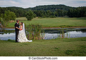 Bride and groom at an outdoor venue - Bride and groom...