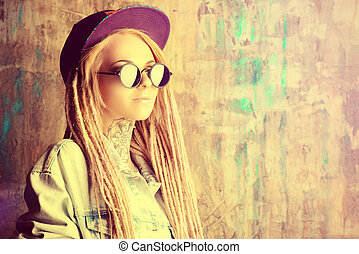 look for party - Modern teenage girl with blonde dreadlocks...