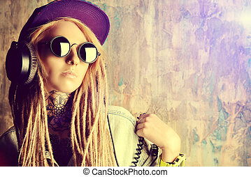 cool DJ - Trendy teenage girl with blonde dreadlocks...