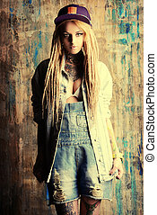 fashion jeans - Modern teenage girl with blonde dreadlocks....
