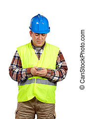 Construction worker sending sms - Construction worker with...