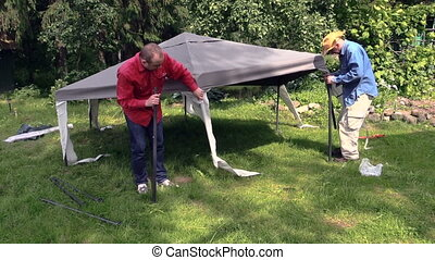 people build garden bower - People stand garden tent bower...