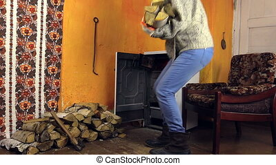 girl bring wood stove - girl with thick woolen sweater and...