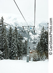 Skilift - Chairlift intermediate tower at Meribel ski...