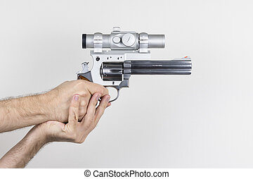 Shooter holds .357 Magnum Revolver - Shooter holds .357...