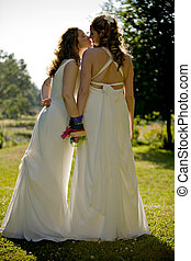 Couple - A newly wed lesbian couple kissing each other