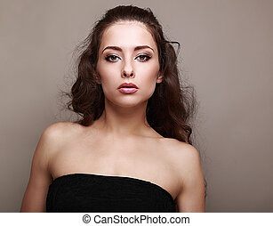 Beautiful makeup female model looking on grey background