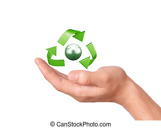 hand holding green Recycling symbol - image of hand holding...