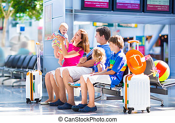 Family at the airport - Big happy family with three kids...