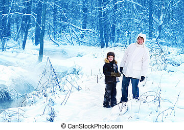 Father and son in a snowy park - Father and sun walking in a...