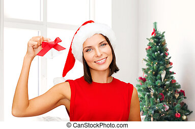 smiling woman in santa hat with jingle bells - holidays,...